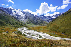 View of the valley in the mountains, glacier and river Stock Image