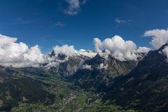 View of the valley from the peak of the swiss alps royalty free stock photography