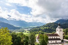 View of the valley and St. Theodula`s Church from Castle Gruyeres, Switzerland royalty free stock photo