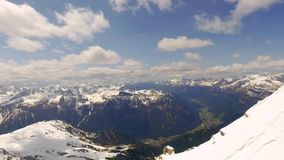 View of the valley from the summit of Sass Pordoi in the Dolomites stock video