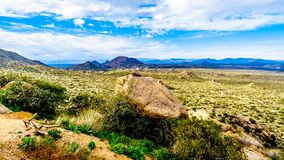 View of the Valley of the Sun and the rugged rocky mountains in the McDowell Mountain Range viewed from the Tom`s Thumb Trail. View of the Valley of the Sun and royalty free stock photo
