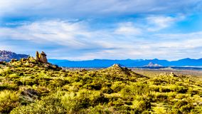 View of the Valley of the Sun and the rugged rocky mountains in the McDowell Mountain Range viewed from th. View of the Valley of the Sun and the rugged rocky royalty free stock photo