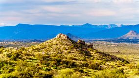 View of the Valley of the Sun and the rugged rocky mountains in the McDowell Mountain Range viewed from the Tom`s Thumb Trail. View of the Valley of the Sun and stock image