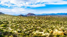 View of the Valley of the Sun and the rugged rocky mountains in the McDowell Mountain Range viewed from the Tom`s Thumb Trail. View of the Valley of the Sun and royalty free stock images