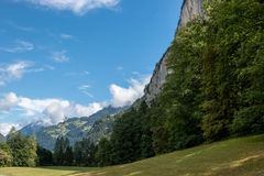View valley of waterfalls in national park of city Lauterbrunnen, Switzerland. Europe. Summer landscape, sunshine weather, dramatic blue sky and sunny day stock photography