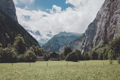 View valley of waterfalls in national park of city Lauterbrunnen, Switzerland. Europe. Summer landscape, sunshine weather, dramatic blue sky and sunny day royalty free stock image