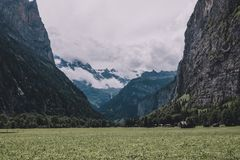 View valley of waterfalls in national park of city Lauterbrunnen, Switzerland. Europe. Summer landscape, sunshine weather, dramatic blue sky and sunny day royalty free stock photography