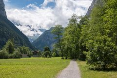 View valley of waterfalls in national park of city Lauterbrunnen, Switzerland. Europe. Summer landscape, sunshine weather, dramatic blue sky and sunny day stock photos