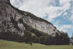 View valley of waterfalls in national park of city Lauterbrunnen, Switzerland. Europe. Summer landscape, sunshine weather, dramatic blue sky and sunny day royalty free stock photos
