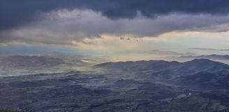 View of valleys just before a storm with clouds and fog, winter, Royalty Free Stock Photos