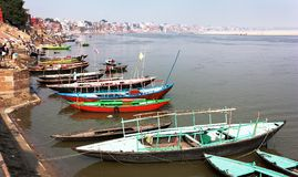 View of Varanasi with boats on sacred Ganga River Stock Photos