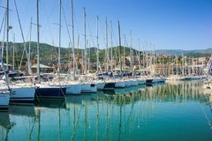 View of Varazze Marina in Liguria, Italy. With yachts and blue sky background Royalty Free Stock Photography