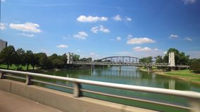 A view of various bridges over Brazos River in Waco Texas. A profile view of various bridges over the Brazos River in downtown Waco, Texas stock video footage