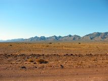 Outback Mountains. A view of the vast Flinders Ranges from the edge of the remote Australian outback desert Royalty Free Stock Photography