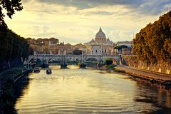 Vatican City and St Peters Basilica across the River Tiber at sunset, Rome, Italy. View of Vatican City and St Peters Basilica across the River Tiber at sunset stock image