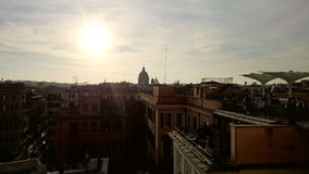 View of the Vatican and Rome from a balcony. Sun shining on Rome, Italy Stock Image