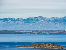 View at the Velebit Mounties range, the Croatia mainland, from islands in the Mediterranean sea Stock Photography