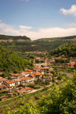 View of Veliko Tarnovo. View of the historic town of Veliko Tarnovo, the stream that runs through the town and the surrounding mountains, Bulgaria Royalty Free Stock Photos