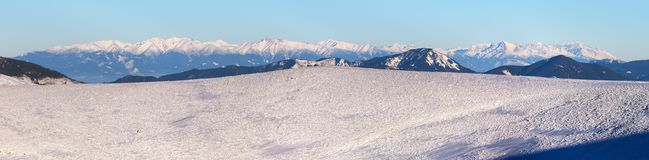 View from Velka Fatra mountains to High Tatras mountains. Panoramic wintry view from Velka Fatra mountains ridge to High Tatras mountains, Slovakia Royalty Free Stock Image