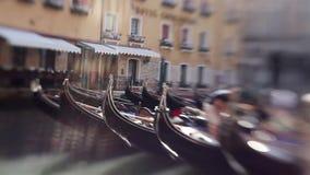 View on a Venetian gondola. Tilt shift effect. Morning sun, refraction of light stock footage