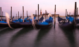 View of Venetian gondolas during sunset. Royalty Free Stock Photos
