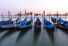View of Venetian gondolas during sunset. Royalty Free Stock Photo