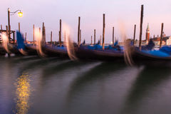View of Venetian gondolas during sunset. Royalty Free Stock Photography