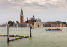 View of the Venetian Lagoon and the Church of San Giorgio Maggiore on island of the same name in Venice, Italy. VENICE, ITALY - 26 JUNE, 2014: View of the royalty free stock images