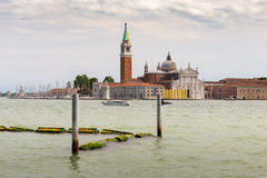 View of the Venetian Lagoon and the Church of San Giorgio Maggiore on island of the same name in Venice, Italy. VENICE, ITALY - 26 JUNE, 2014: View of the royalty free stock photo