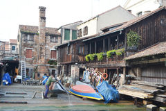 View in Venice. Master repairing gondola. Royalty Free Stock Photo