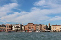 View of Venice from the sea shore. Full of historical buildings, bridges and boats Royalty Free Stock Image