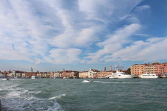 View of Venice from the sea shore. Full of historical buildings, bridges and boats Stock Images