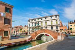 View of The Venice Street and canal with boats and small bridge in Venice sunny day, Italy. Royalty Free Stock Photo