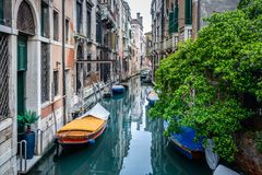 View of Venice traditional canal with boats .Venice is a popular tourist destination of Europe. View of Venice traditional canal with boats .Venice is a popular Royalty Free Stock Photos