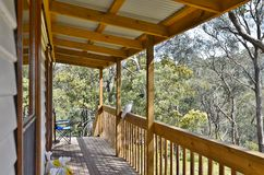 View From The Veranda. A white cockatoo sits on the railing of a veranda on a house in a rural setting in country Victoria, Australia Stock Image