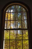 View of Vermont fall foliage from an arched window. royalty free stock photography