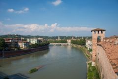 A view of Verona city, Italy. The river Adige and a view of ponte della Vittoria, Victory bridge. The view is from The bridge of Castellvecchio. Summer day and a stock photography