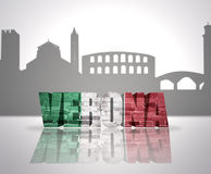 View of Verona. Word Verona with national flag of italy near skyline silhouette Stock Photos
