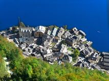 View vertically from the top. The town on the shore of the Alpine lake. stock photo