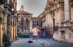 View of Via dei Crociferi and San Benedetto Arch stock images