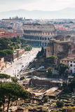 View of Via dei Fori Imperiali and Colosseum. Travel to Italy - above view of Via dei Fori Imperiali and Colosseum from Capitoline Hill in Rome city in winter Stock Photo