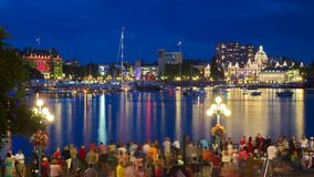 View of Victoria city Inner harbor with crowds waiting for fireworks display. Royalty Free Stock Image