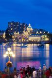 View of Victoria city Inner harbor with crowds waiting for fireworks display. Royalty Free Stock Photography