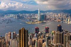 View on Victoria harbour in Hong Kong. View from peak Victoria on Victoria harbour with skyscrapers and blue cloudy sky Royalty Free Stock Images