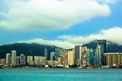 View of Victoria`s harbor from Tsim Sha Tsui TST waterfront, Hong Kong, China royalty free stock photo
