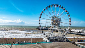 View of the Victorian Brighton Pier and the Brighton wheel. In a windy day Stock Photo