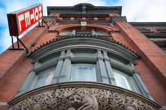View of Victorian Hotel from Below. View of Victorian hotel with sign directly from below royalty free stock photo