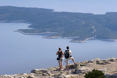 View from Vidova Gora. Tourist couple looking at Hvar island from Vidova Gora on island Brac stock image