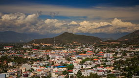 View of Vietnam resort city against mountains clouds blue sky stock footage
