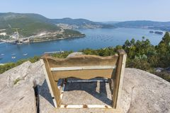 View of Vigo estuary Pontevedra, Spain. Wooden bench in Redondela Pontevedra, Spain Royalty Free Stock Image